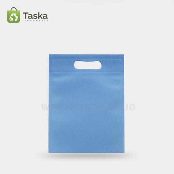 Tas-Spunbond-Oval-Biru-Muda–25×35-Cm-Sisi-Depan