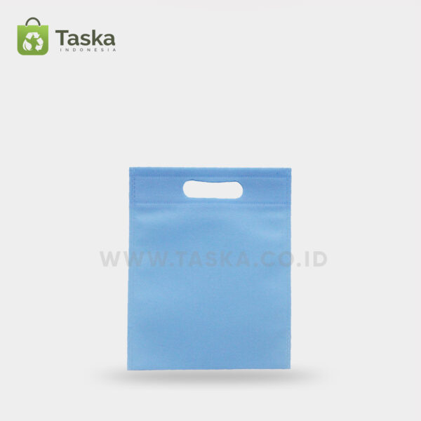Tas Press Spunbond Oval – Biru Muda 20×25 Cm – Sisi Depan