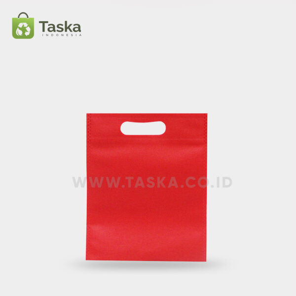 Tas Press Spunbond Oval – Merah 20×25 Cm – Sisi Depan