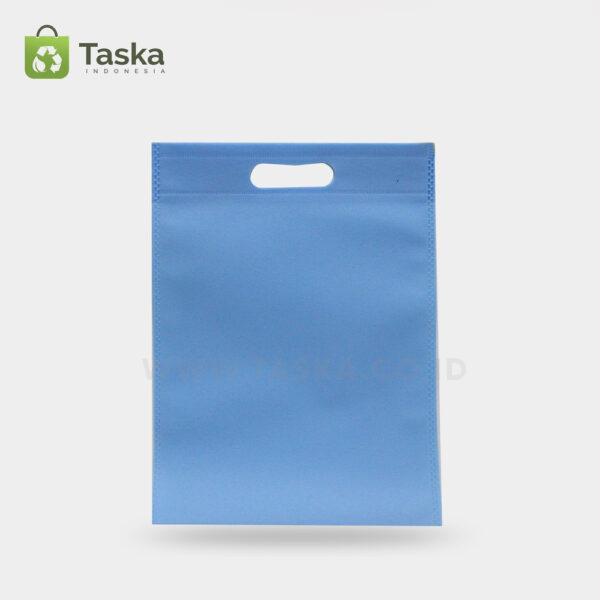 Tas-Spunbond-Oval-Biru-Muda-30×40-Cm-Sisi-Depan