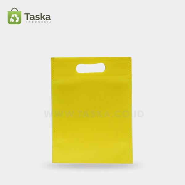 Tas-Spunbond-Oval–Kuning-25×35-Cm–Sisi-Depan