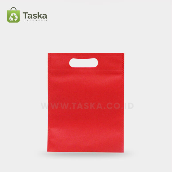 Tas-Spunbond-Oval–Merah-25×35-Cm-Sisi-Depan