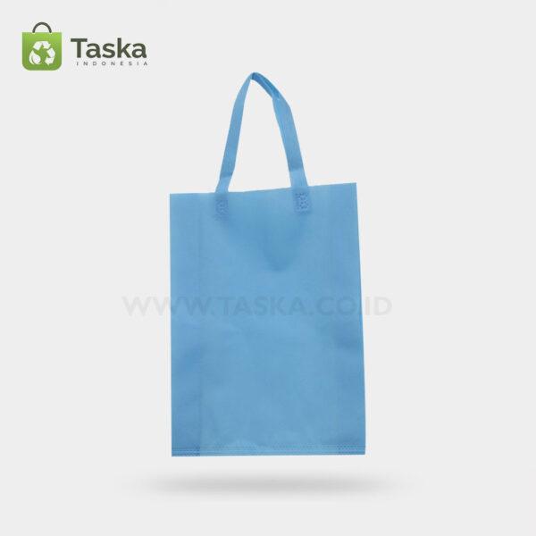 Tas Press Spunbond Handle – Biru Muda 30×40 Cm – Sisi Depan