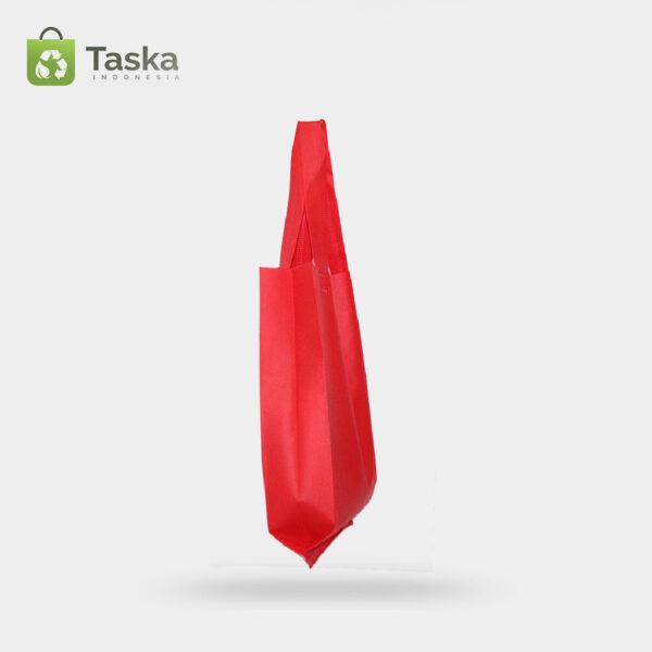 Tas Press Spunbond Handle – Merah 25×35 Cm – Sisi Kiri