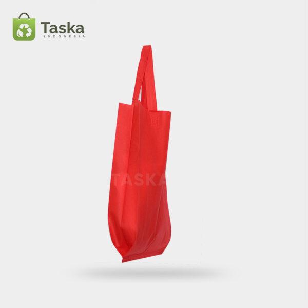 Tas-Press-Spunbond-Handle—-Merah-30×40-Cm—Sisi-Samping-Kanan