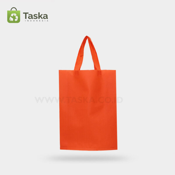 Tas Press Spunbond Handle – Orange 25×35 Cm – Sisi Depan