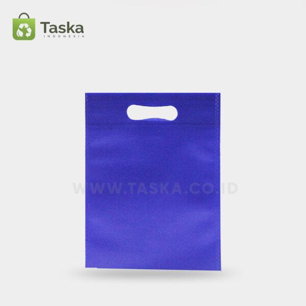 Tas-Spunbond-Oval-Biru-Tua-25×35-Cm-Sisi-Depan